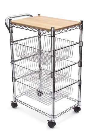 <b>Photo 4: Kitchen cart on wheels</b></br> <p>A rolling kitchen cart is the next best thing to adding cabinets and countertop space. The top provides extra workspace when you're preparing that big Thanksgiving dinner. And the shelves below hold items that would otherwise consume countertop space. If you plan to use a cart for food preparation, choose one with a tough top like butcher block, stainless steel or plastic laminate. Some cart tops are glossy finished wood—beautiful, but not very durable. Carts come in a variety of wood finishes, so there's a good chance you can match your existing cabinets. Or you can go for an eclectic look with a shiny metal or painted cart. </p> <p>For a huge selection, shop online.</p>
