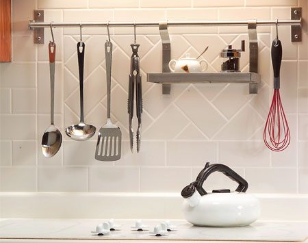 <b>Photo 7: Backsplash that holds utensils</b></br> Backsplash racks offer easy access and stylish storage. Most versions take just a few minutes to install. You'll also find a huge range of prices. Backsplash racks have a few disadvantages, though. All your kitchen utensils have to look good, since they're on display. And if you ever decide to remove the rack, you&39;ll be left with screw holes in the backsplash; not a big problem with drywall, but ugly and unfixable in tile.