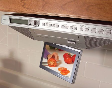 <b>Photo 8: Entertainment center under the cabinets</b></br> Replace that countertop TV with an under-cabinet model. On most models, the screen folds up and out of your way when not in use. Basic models include a radio, and pricier versions play CDs or DVDs too. Find under-cabinet TVs at electronics stores. You can even buy an under-cabinet TV system that includes a camera, which lets you monitor the front door or the backyard from the kitchen. Under-cabinet TVs are easy to mount—all you need is a drill and a screwdriver. But running cable or antenna wire to the TV probably won't be so easy. Make sure you can connect a TV before you buy one.