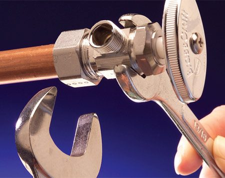 <b>Photo 3: Tighten the fitting</b></br> Tighten the compression fitting. The pipe joint compound provides a greater margin of safety.