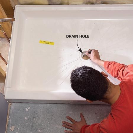 <b>Photo 4: Mark the new drain</b></br> Set the shower base in place and mark the drain hole.