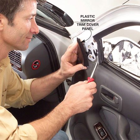 <b>Photo 1: Remove the mirror trim panel</b></br> Pop off the mirror trim panel using the Door Panel Remover tool.