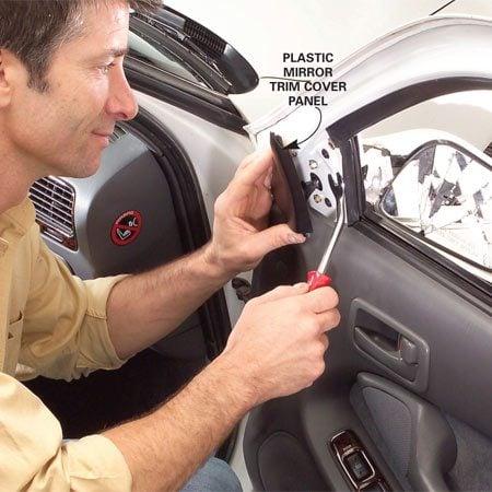 <b>Photo 1: Remove the mirror trim panel</b></br> Pop off the mirror trim panel using the Door Panel Remover tool.