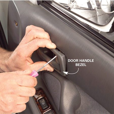 <b>Photo 3: Remove the door handle bezel</b></br> Check for retaining screws holding the door handle bezel. If there aren't any, that's your clue that it snaps into place. Use a small flat-blade screwdriver to undo the snaps.