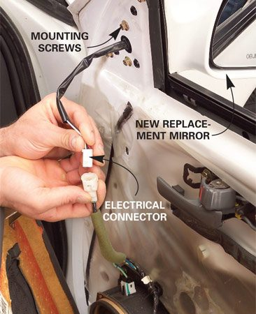 <b>Photo 5: Test the mirror</b></br> Connect the electrical connector and test the mirror. Then reassemble the door panel, reinstalling it in the reverse order that it was removed.