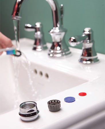 <b>Photo 2: Clean the pieces</b></br> Disassemble the aerator and lay out the parts in the order you remove them to make reassembly foolproof. Scrub the parts and reassemble them.