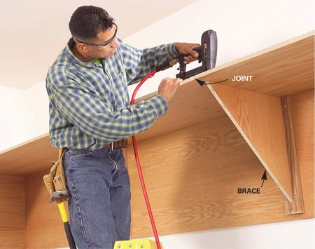 <b>Photo 6: Nail the shelves</b></br> Nail the shelves to the apron and to the braces with 2-in. nails spaced every 8 in. Make sure joints meet at the center of the 3/4-in. braces.