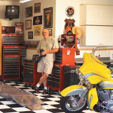<b>Cool bike, cool lift, cool garage!</b></br> A motorcycle lift raises bikes to comfortable working height.