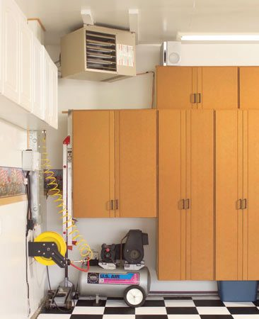 <b>Problem solver</b></br> A half-height cabinet provides storage space as well as niches for an air compressor, a heater and other utilities.