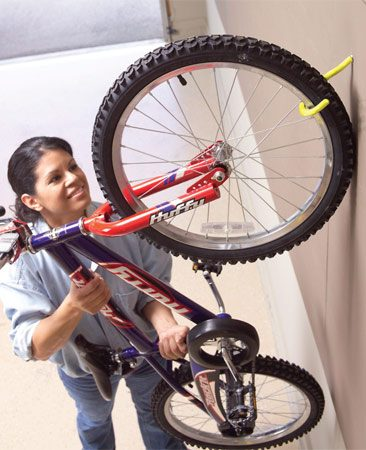 Drill a hole at a 45-degree angle and turn in a screw<br/> hook to hang a bicycle by the front wheel.