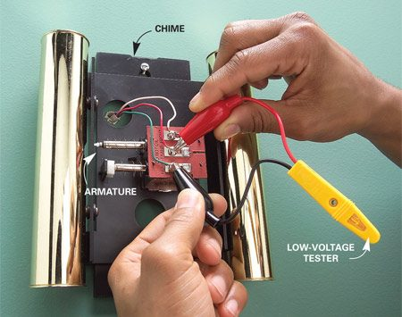 <b>Photo 3: Chime</b></br> Remove the chime cover and check for voltage while a helper pushes the button.