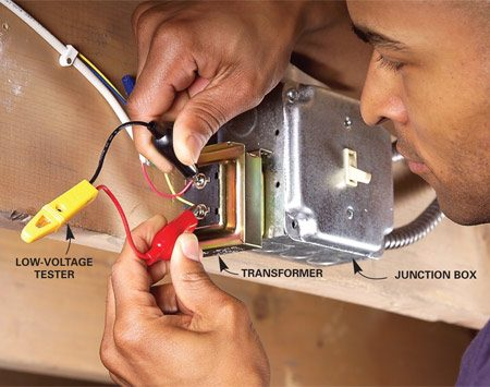 <b>Photo 4: Transformer</b></br> Test the transformer by touching the screw terminals with a low-voltage test light. If the tester doesn't light up, replace the transformer.