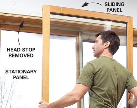 <b>Photo 2: Remove the head stop and door</b></br> Latch the door, then unscrew and remove the inside head stop. Unlatch the door, tip the top of the sliding panel inward and lift it free of the track.