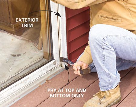 <b>Photo 4: Remove the stationary panel</b></br> Pry the stationary panel free of the frame at the top and bottom, slitting caulk or paint as necessary with a utility knife. Tip it inward and lift it free.