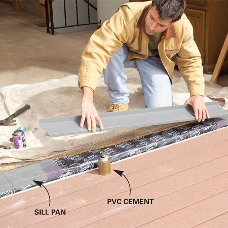 <b>Photo 7: Install a sill pan</b></br> Prep and lay a special vinyl sill pan over the flashing. Clean the joint overlaps with PVC cleaner, then lay the parts in place and weld the seams with PVC cement.