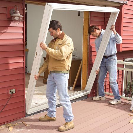 Replace a patio door the family handyman - How to install an exterior sliding barn door ...
