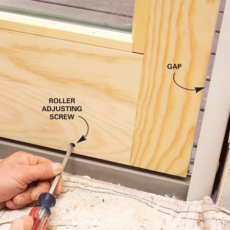 <b>Photo 11: Adjust the door</b></br> Slide the door slightly open and adjust the roller heights until the gap between the jamb and the panel is consistent.