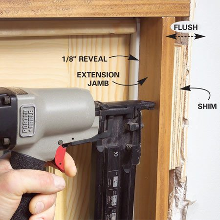 <b>Photo 12: Add extension jambs and trim</b></br> If you need extension jambs, rip them to width and then shim and nail them into place, leaving a 1/8-in. reveal at the door frame. Then add the casing with another 1/8-in. reveal.