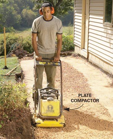<b>Compact each layer as you go</b></br> Depending on the type of soil, most paths, patios and walls require an 8- to 12-in.- deep compacted base of gravel. But if you just dump 8 in. of gravel into a trench and run a plate compactor over it, only the top few inches will be fully compacted. The uncompacted gravel will settle later, creating waves in the wall or path. For a fully compacted base that won't settle, add the gravel in 2- or 3-in.-deep layers, and run the plate compactor over each layer before adding the next one.
