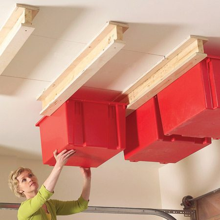 <b>Hang storage bins from the ceiling</b></br> This simple combination of plastic bins and homemade support carriages is perfect for holiday decorations and other rarely needed stuff. To make the carriages, just screw and glue 3/4-in. plywood flanges to 2x4s. Then screw the carriages to ceiling joists and slide in the bins. The heavy-duty bins we used cost about $17 each at simplastics.com (item snt-230- BL).   <a href='http://www.familyhandyman.com/DIY-Projects/Home-Organization/Garage-Storage/create-a-sliding-storage-system-on-the-garage-ceiling'>Get more details on building this system here</a>.