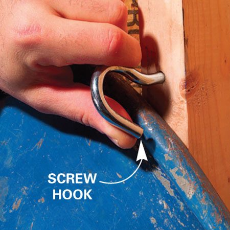 <b>Use screw hooks as latches</b></br> Special hardware is available at some home centers, but you can easily build it yourself. Substitute a scrap of 1x4, a pair of mending plates and screw hooks that act as latches.