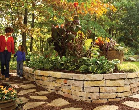 <b>Raised bed and garden</b></br> The stone wall and flagstone path blend perfectly into a lush garden setting.