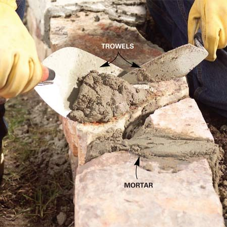 <b>Photo 10: Fill the joints</b></br> Pack mortar into the joints on the top and front of the capstones. Brush off crumbs of mortar after they dry.