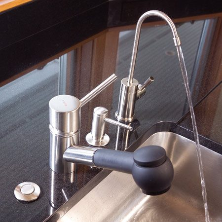 Modern faucet and filtered water and soap dispensers