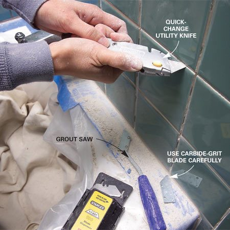<b>Photo 2: Scratch out the grout</b></br> Scratch out at least 1/8 in. of grout from all the horizontal and vertical lines with a utility knife or grout saw. Change blades often.