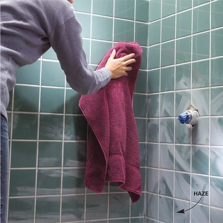 <b>Photo 9: Buff off the grout haze</b></br> Buff the haze off the tile after the grout dries (several hours). Use an old terry cloth towel.