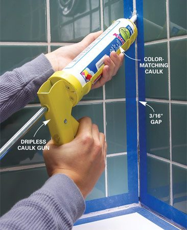 <b>Photo 10: Caulk the corners</b></br> Apply painter's tape to control your caulk lines. Apply the caulk, smooth the joint with your finger and immediately remove the tape.