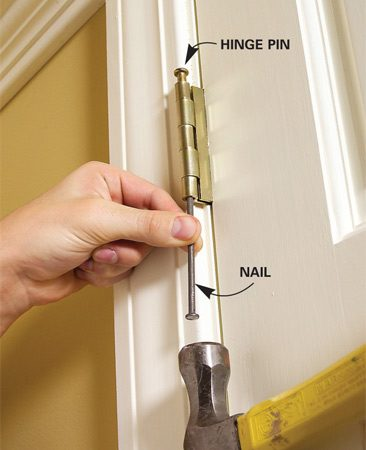 <b>Photo 1: Loosen the hinge pin</b></br> Close the door and tap the hinge pins loose with a hammer and nail.