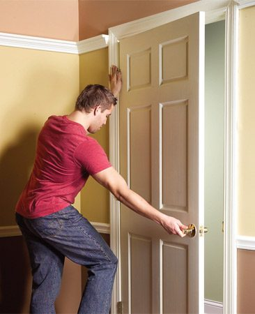 <b>Photo 3: Remove the door</b></br> Open the door partway and pull it to the side so it drops off the hinges.