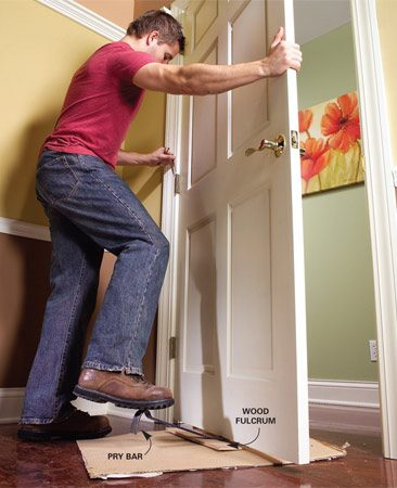 <b>Photo 4: Remount the door</b></br> Replace the door on the hinges, using a pry bar if necessary to get the hinge leaves to fit together.