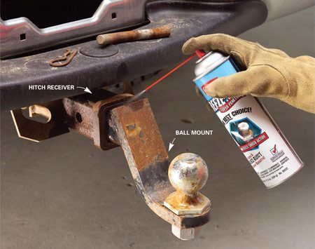 <b>Photo 1: Spray the rusted joint</b></br> Generously spray the opening to the hitch receiver with a penetrating fluid. Then insert the spray straw deep into the corners of the receiver and spray liberally.