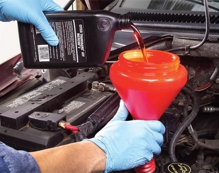 <b>Photo 4: Refill with new fluid</b></br> Read on the tank the amount of fluid you withdrew and refill the transmission with that amount of new fluid.