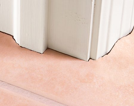 Photo 1: Tile cut to fit casing