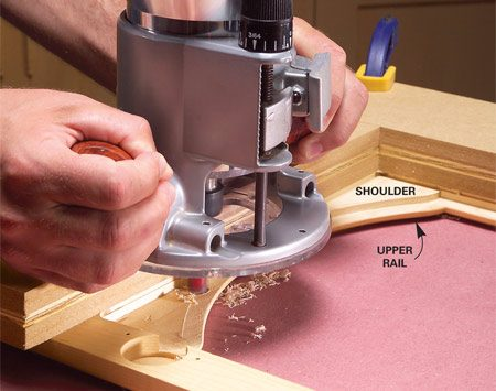 <b>Photo 2: Arched window technique</b></br> Lower the router bit and cut away the shoulders on the back side of an arched upper rail to create a square recess for the glass.