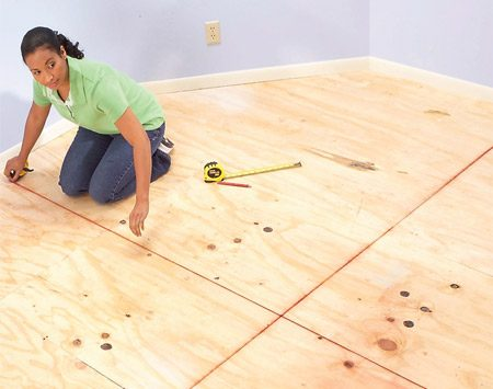 <b>Photo 2: Layout lines</b></br> Clean the floor, then snap chalk lines parallel to the walls to create perpendicular baselines.