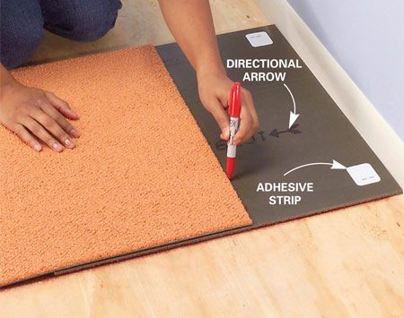 <b>Photo 4: Cut tight to walls</b><br/>Place the last carpet square face down against the wall and under the previous square. Mark it, cut it to size with a carpet knife and install it.