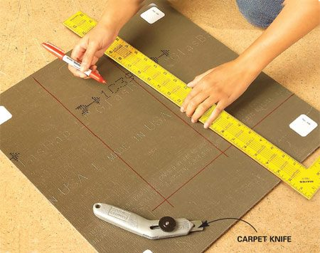 <b>Photo 7: Cut on the back </b><br/>Flip the square over and use a marker and a carpenter&#39;s square to draw the wall shape from the marks you just made. Cut out the opening.
