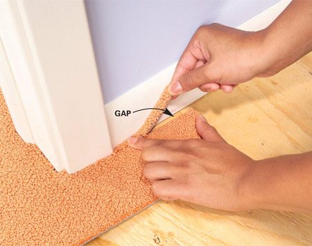 <b>Photo 10: Fillers hide mistakes</b><br/>Cut filler pieces from scrap to fill any gaps between the walls and squares. Wedge the pieces into place, then smooth them with your hand.