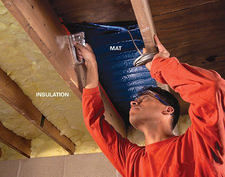 <b>Photo 3: Under-floor technique</b></br> Staple mats between joists to heat the floor above. Then insulate the underside of the mat with R-13 or thicker fiberglass batts.