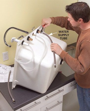 <b>Photo 8: Install the sink</b></br> Make the sink cutout in the countertop with a jigsaw. Mount the faucet, the supply lines and the drain on the sink. Then lay a bead of caulk around the cutout and drop in the sink.