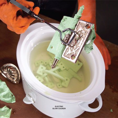 <b>Hot water paint stripping</b></br> Soak painted hardware in hot water to loosen many layers of paint and make cleaning much easier.