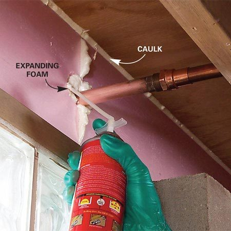 <b>Photo 2: Caulk around openings</b></br> Run a bead of acrylic caulk around each section of foam to form an airtight barrier. Fill gaps larger than 1/4 in. with expanding foam sealant.