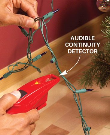 <b>Photo 2: Find a bad bulb</b></br> Press down the black button, hold the tip about 1/2 in. from the string, and move it along the cord until it stops beeping (at the defective bulb).