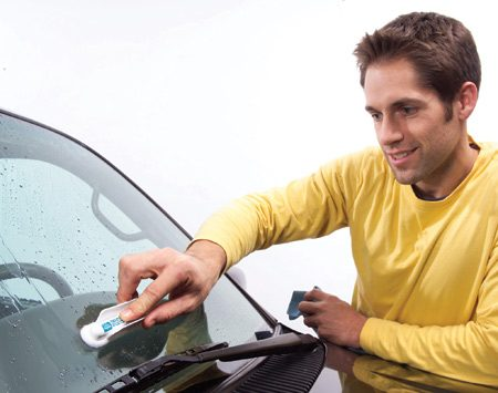 <b>Applying treatment</b></br> Squeeze the wings on the Aquapel applicator to start the flow of the fluid. Apply to the windshield. Wipe off. Repeat.