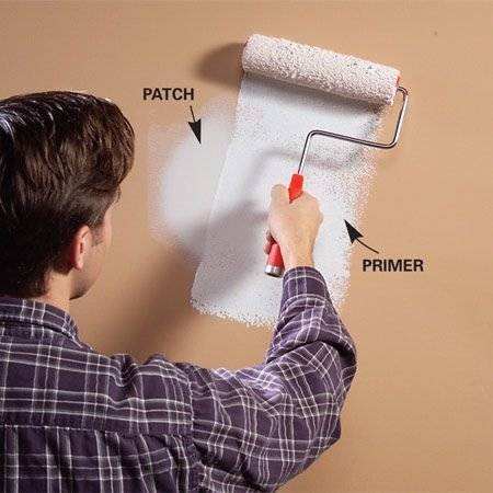 <b>Photo 2: Prime the patch </b></br> Remember to prime the patched area before painting.
