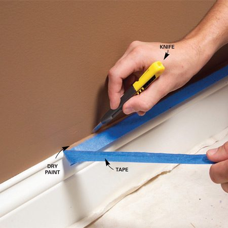 <b>Photo 1: Cut, then pull</b><br/>Once cut, the tape comes off cleanly without tearing the dry paint.